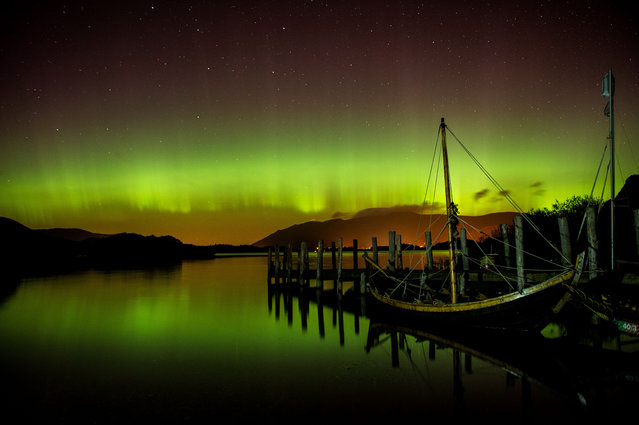 The aurora borealis, or the northern lights occur over Derwentwater, near Keswick, England, Thursday October 8, 2015. The northern lights are the result of collisions between gaseous particles in the Earth's atmosphere with charged particles released from the sun. (Photo by Owen Humphreys/PA via AP Photo)