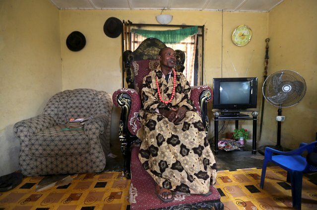 Deputy community chief of Yeneka village Douglas Oguta poses for a portrait in his home on the outskirts of the Bayelsa state capital, Yenagoa, in Nigeria's delta region October 8, 2015. (Photo by Akintunde Akinleye/Reuters)