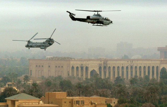 U.S. Marine helicopters patrol the skies over Baghdad, on April 13, 2003. (Photo by Gleb Garanich/Reuters/The Atlantic)