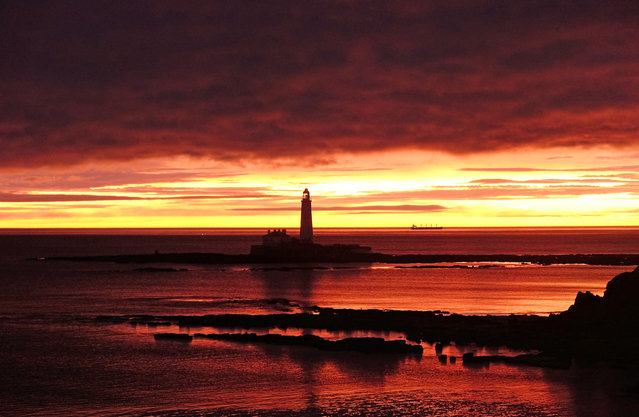 The sun rises behind St Mary's lighthouse in Whitley Bay, Tyne and Wear, England on December 20, 2017. (Photo by Owen Humphreys/PA Images via Getty Images)