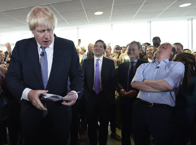 Britain's Prime Minister David Cameron (R) laughs as London Mayor Boris Johnson speaks during an election rally in Hendon in north London, Britain May 5, 2015. (Photo by Toby Melville/Reuters)