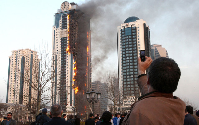 A multi-storey building, which is part of the Grozny-City complex, is seen on fire in the Chechen capital Grozny, Russia, April 3, 2013. No casualties were reported. (Photo by Elena Fitkulina/AFP Photo)