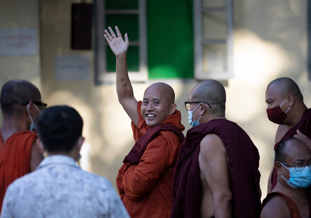 Myanmar nationalist Buddhist monk U Wirathu (C) waves to supporters outside the Yangon western district police station, Yangon, Myanmar, 02 November 2020. Wirathu, who has been on the run since May 2019, surrendered himself to police on 02 November. Yangon Western District Court on 28 May 2019 had issued an arrest warrant against him under sedition laws article 124(a) for his attempts to excite disaffection towards the government, a crime carrying a maximum penalty of life imprisonment. (Photo by Lynn Bo Bo/EPA/EFE)