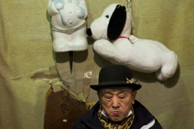 A trader sells secondhand goods at Boroichi flea market in Tokyo December 15, 2014. (Photo by Thomas Peter/Reuters)