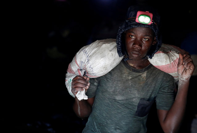 A young gold miner works in Makala gold mine camp near the town of Mongbwalu in Ituri province, eastern Democratic Republic of Congo on April 7, 2018. (Photo by Goran Tomasevic/Reuters)
