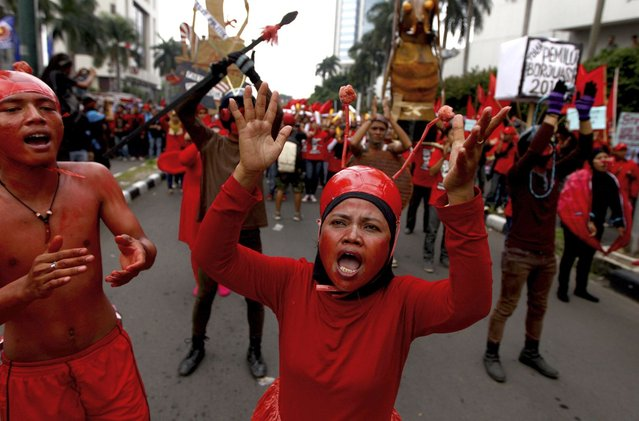 Indonesian workers painted in red chant slogans during a May Day rally in Jakarta, Indonesia, Wednesday, May 1, 2013. (Photo by Dita Alangkara/AP Photo)
