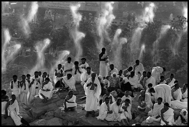 Mecca, Saudi Arabia, 1992. Pilgrims from around the world pray on Mount Rahma, where Muslims believe Adam met Eve. (Photo by Abbas Attar/Magnum Photos)