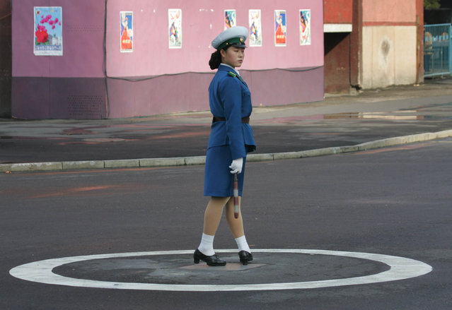 A North Korean traffic policewoman works in central Pyongyang October 15, 2005. (Photo by Reinhard Krause/Reuters)