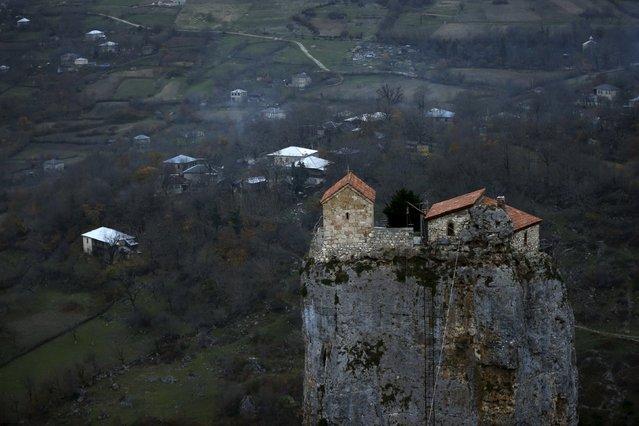 A church is seen on top of the Katskhi Pillar, a rock mass about 40 meters high, in the village of Katskhi, Georgia, November 27, 2015. (Photo by David Mdzinarishvili/Reuters)