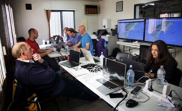 Google's team at mission control monitors a balloon launch in Christchurch, New Zealand. (Photo by Andrea Dunlap/Google)