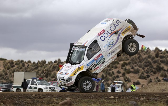 Argentine Juan Manuel Silva and Pablo Sisterna (not pictured) crash and roll their Mercedes car during the 7th stage of the Dakar Rally from Iquique to Uyuni, January 10, 2015. (Photo by Daniel Rodrigo/Reuters)