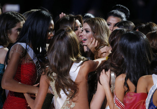 Other contestants comfort Miss Colombia Ariadna Gutierrez, center, after she was incorrectly crowned Miss Universe at the Miss Universe pageant on Sunday, December 20, 2015, in Las Vegas. Miss Philippines Pia Alonzo Wurtzbach was named Miss Universe. (Photo by John Locher/AP Photo)