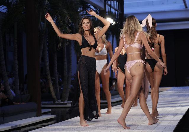 Models walk down the runway during the Fashion Palette Miami Australian Swim Show during Miami Swim Week, Sunday, July 15, 2018, in Miami Beach, Fla. (Photo by Lynne Sladky/AP Photo)