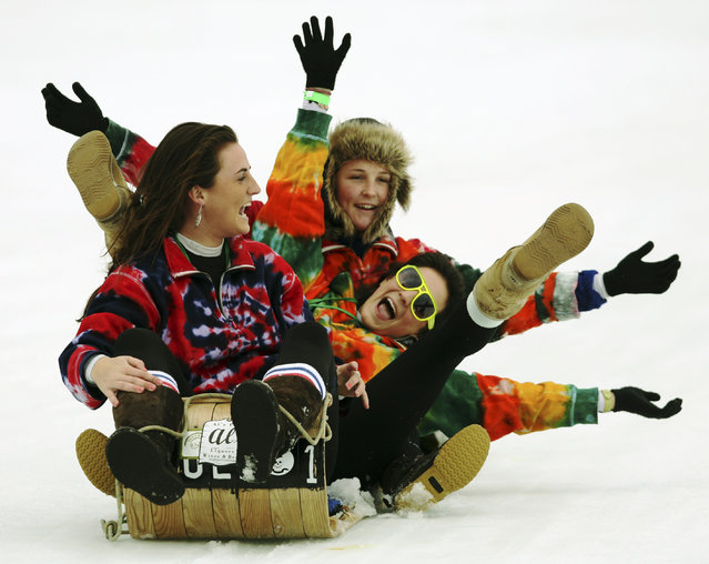 In this February 8, 2009 file photo toboggan racing contestants enjoy their ride in the National Toboggan Championships in Camden, Maine. The U.S. National Toboggan Championships will take place from February 6 to 8, 2015, at Camden Snow Bowl, The upcoming championships draws participants from across the country for a race down the toboggan chute onto Hosner Pond. It's the only race of its kind in the world, organizers say. (Photo by Pat Wellenbach/AP Photo)