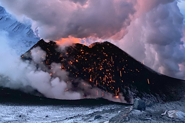 Smoke rises from the erupting Klyuchevskoy volcano on Russia's Kamchatka Peninsula on March 8, 2021. (Photo by Boris Smirnoff/TASS)