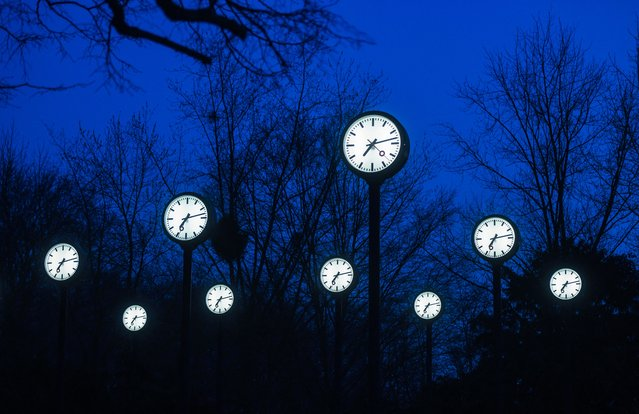 "Clocks of the art installation ""Zeitfeld"" (time field) by German artist Klaus Rinke are seen in Duesseldorf, western Germany, on March 23, 2021. Clocks in Germany will be changed to summer time and set back by one hour on Sunday, 28 March 2021. (Photo by Ina Fassbender/AFP Photo)"