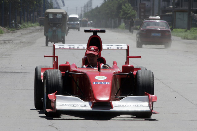 Zhao Xiuguo drives a homemade model of Formula One car in Tangshan, Hebei Province, some 180km (113 miles) east of Beijing July 21, 2006. Zhao Xiuguo and his brother Zhao Xiushun built the car from scrap metal and said that they wanted to design and build the first Formula One racecar in China. (Photo by Claro Cortes IV/Reuters)