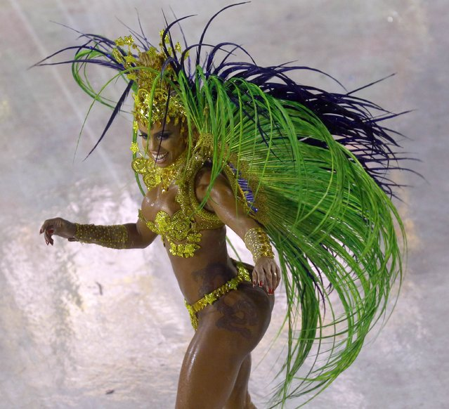 A reveller from the Viradouro samba school participates in the annual carnival parade in Rio de Janeiro's Sambadrome, February 15, 2015. (Photo by Ricardo Moraes/Reuters)