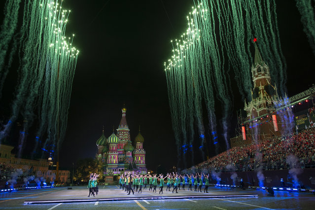 Russian participants perform during the closing of the Spasskaya Tower international military music festival in Red Square with the St. Basil's Cathedral in the background, in Moscow, Russia, Sunday, September 2, 2018. (Photo by Alexander Zemlianichenko/AP Photo)