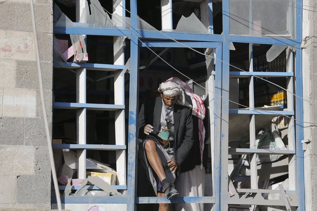 A vendor steps out of his shop damaged by a Saudi-led air strike in Yemen's capital Sanaa January 4, 2016. (Photo by Khaled Abdullah/Reuters)