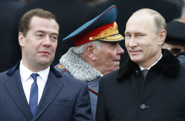 Russian President Vladimir Putin (R) and Prime Minister Dmitry Medvedev attend a wreath-laying ceremony to mark the Defender of the Fatherland Day at the Tomb of the Unknown Soldier by the Kremlin walls in central Moscow February 23, 2015. (Photo by Sergei Karpukhin/Reuters)