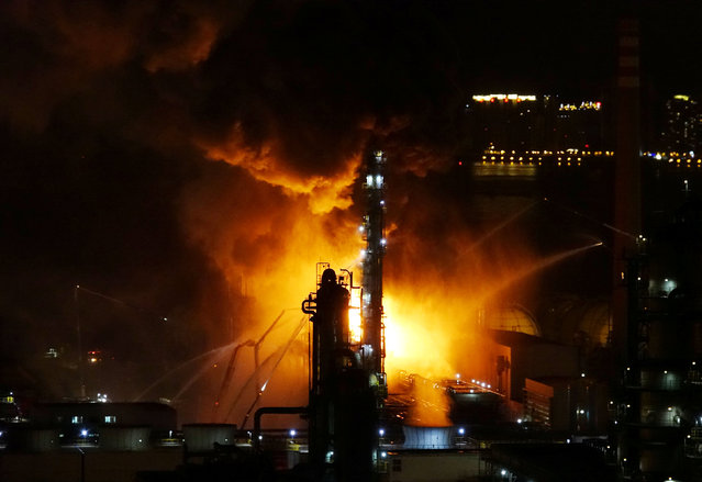 Fire and smoke are seen at state oil major PetroChina's plant in Dalian, Liaoning province, China August 17, 2017. (Photo by Reuters/China Stringer Network)