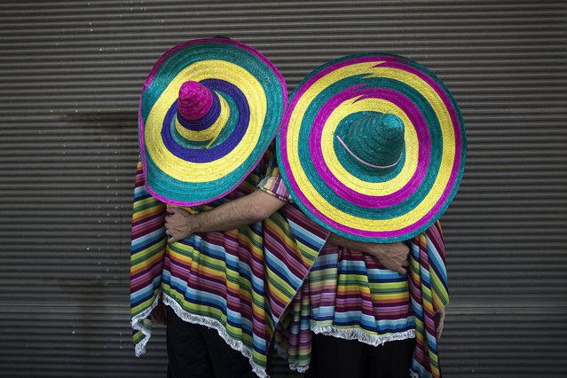 Israeli couple in costume pose for a photograph as they attend a gay party on the occasion of the Jewish holiday of Purim in Tel Aviv, Israel, 07 March 2015. Purim celebrates the Jews' salvation from genocide in ancient Persia, as recounted in the Scroll of Esther.  EPA/ABIR SULTAN