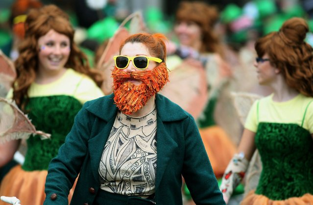 Crowds enjoy the Dublin St Patrick's day parade, as it makes its way down O'Connell Street towards St Patrick's Cathedral on March 17, 2015. (Photo by Brian Lawless/PA Wire)