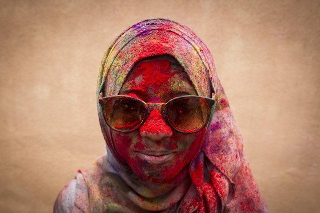 A Malaysian Muslim woman poses for a photo during the religious spring festival Holi in Kuala Lumpur, Malaysia on Saturday, March 21, 2015. Holi, the Hindu festival of colors, is celebrated by people throwing colored powder and water at each other. (Photo by Joshua Paul/AP Photo)