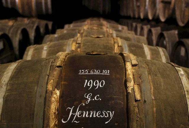 Oak barrels are stored in a cellar used for storing rare and old cognac at the Hennessy factory in Cognac, France, in this November 5, 2015 file photo. LVMH, owner of the Hennessy Cognac brand, is expected to report annual results this week. (Photo by Regis Duvignau/Reuters)