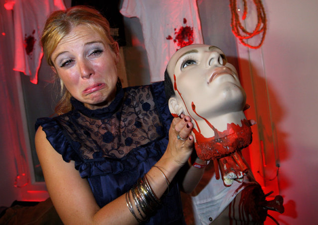 Nina Eichinger poses for a picture with a fake head of a horror figure prior to the shocking shorts award ceremony on June 30, 2009 in Munich, Germany. (Photo by Miguel Villagran/Getty Images)