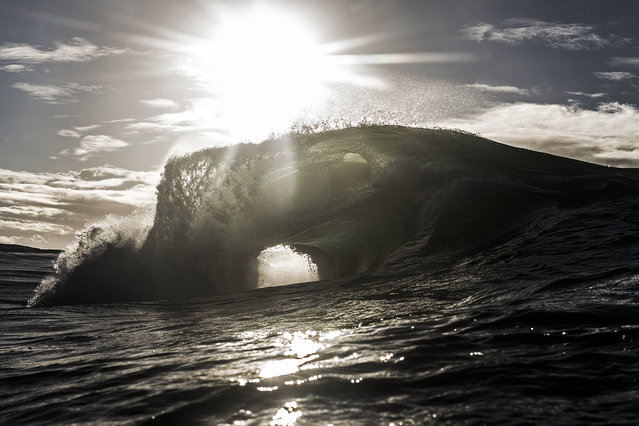 Collins says he enjoys capturing the moment before the moment, the anticipation, not knowing how the end of the wave's journey will play out. (Photo by Ray Collins)