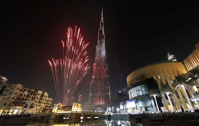 Fireworks explode around at the world's tallest building, Burj Khalifa, in Dubai during the New Year celebrations, UAE, January 1, 2017. (Photo by Reuters/Stringer)