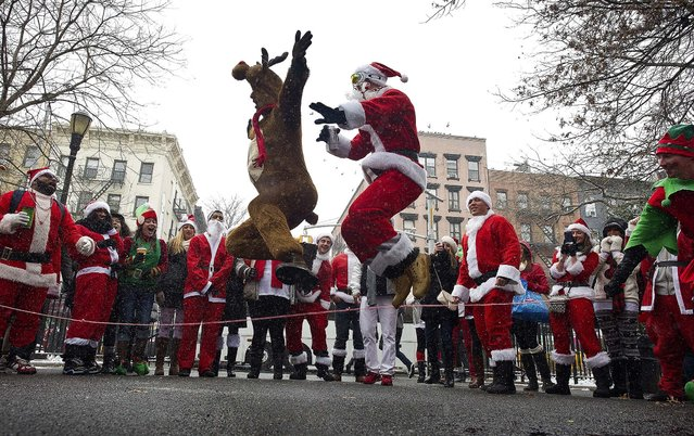 SantaCon 2013 participants jump rope at Tompkins Square Park in the Lower East Side neighborhood of New York. (Photo by Joshua Bright/The New York Times)