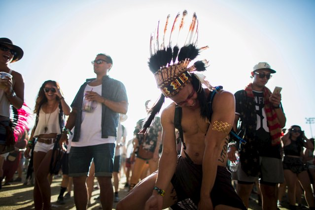 People dance at the Coachella Valley Music and Arts Festival in Indio, California April 11, 2015. (Photo by Lucy Nicholson/Reuters)