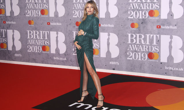 Model Abbey Clancy poses for photographers upon arrival at the Brit Awards in London, Wednesday, February 20, 2019. (Photo by Joel C. Ryan/Invision/AP Photo)