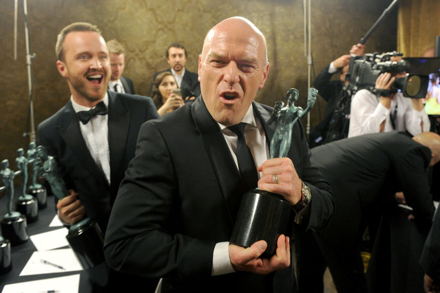 Actors Aaron Paul (L) and Dean Norris attend the 20th Annual Screen Actors Guild Awards at The Shrine Auditorium on January 18, 2014 in Los Angeles, California. (Photo by Kevin Winter/WireImage)