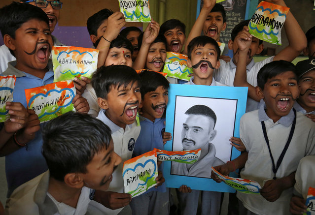School children react as they celebrate the release of Indian Air Force pilot Wing Commander Abhinandan Varthaman by Pakistan on Friday, during a ceremony inside a school in Ahmedabad, India, March 2, 2019. (Photo by Amit Dave/Reuters)
