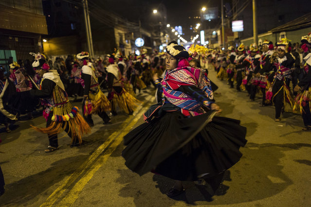 In this January 29, 2017 photo, dancers perform during Virgin of Candelaria celebrations in downtown Puno, Peru. The annual celebration is a rare moment of national focus on an indigenous-dominated village culture in Peru. (Photo by Rodrigo Abd/AP Photo)