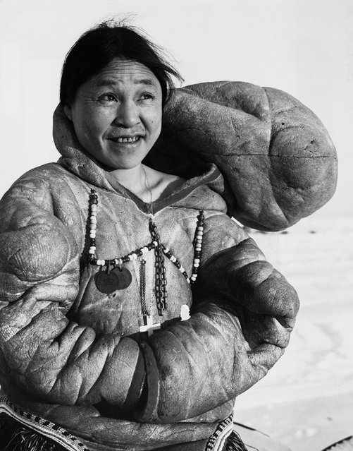 Inuit Woman Wearing Traditional Dress. Eskimo woman wears the tall, floppy hood of her tribe. Eskimos are more properly referred to as Inuits. The term Eskimo is considered derogatory. (Photo by Hulton-Deutsch Collection/Corbis via Getty Images)