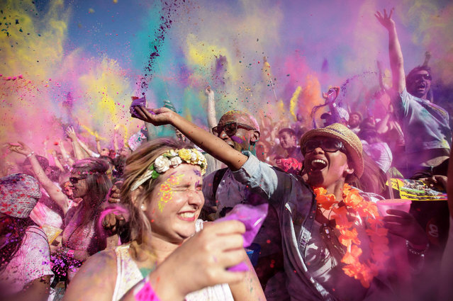 Party-goers partake in a festival better known as Holi One, during International Workers Day in Johannesburg, South Africa, 01 May 2015. The colour festival promotes togetherness as well as colourness in everday life. May Day is observed worldwide every year on 01 May. (Photo by Kevin Sutherland/EPA)
