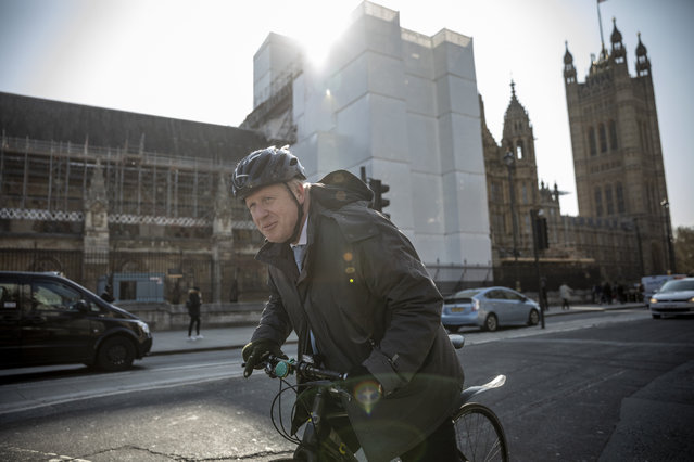MP Boris Johnson cycles into Westminster on April 1, 2019 in London, England. MPs in Parliament will vote on alternative arrangements for Brexit in a series of indicative votes tonight after Mrs May's deal was defeated for a third time in the House of Commons last week. (Photo by Dan Kitwood/Getty Images)