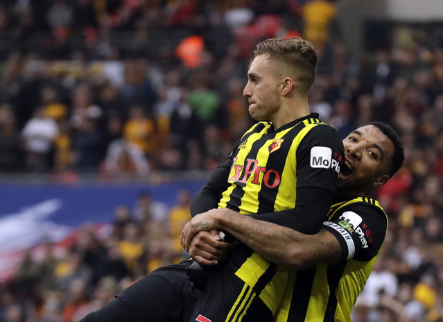 Watford's Gerard Deulofeu, left, celebrates with Watford's Troy Deeney after scoring his side's third goal during the English FA Cup semifinal soccer match between Watford and Wolverhampton Wanderers at Wembley Stadium in London, Sunday, April 7, 2019. (Photo by Matt Dunham/AP Photo)
