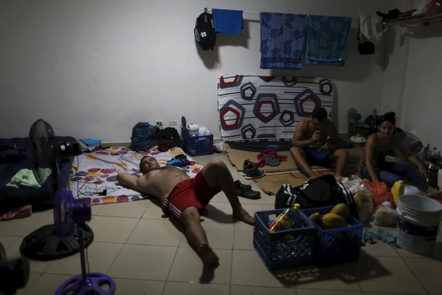 Cuban migrants rest in one of the rooms of an old hotel used as a provisional shelter in Paso Canoas, at the border with Costa Rica, in Panama March 21, 2016. (Photo by Carlos Jasso/Reuters)
