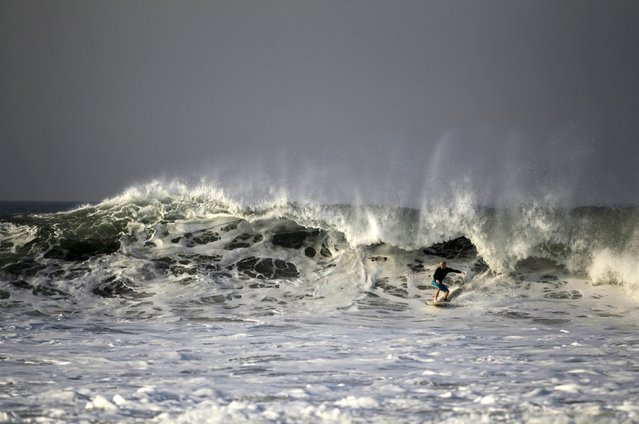 A surfer rides a wave at Punta Roca Beach in La Libertad May 13, 2015. (Photo by Jose Cabezas/Reuters)