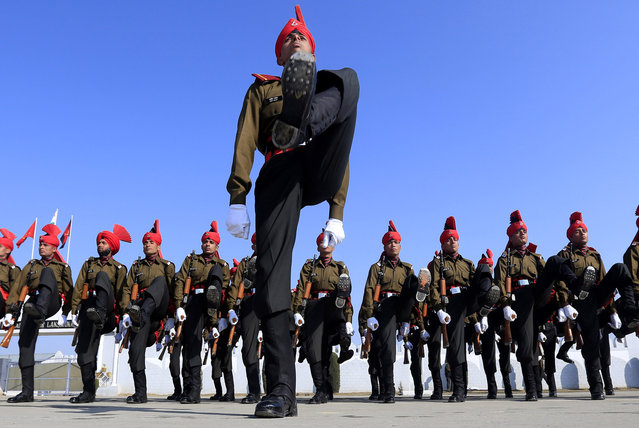 Newly graduated soldiers of the Jammu and Kashmir Light Infantry march during their commencement parade at a military base on the outskirts of Srinagar, India, Saturday, March 8, 2014. The soldiers will join Indian Army fighting separatist Islamic guerrillas in Kashmir to end an insurgency that started in 1989. (Photo by Dar Yasin/AP Photo)