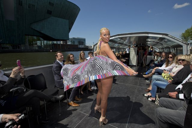 A model sports beachwear designed by Gottex during the Canal Catwalk fashion show dedicated to Kate, Duchess of Cambridge, during the first edition of the World Fashion Fair in Amsterdam, Netherlands, Thursday, May 21, 2015. (Photo by Peter Dejong/AP Photo)