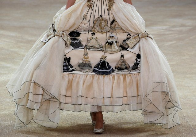 A model presents a creation by designer Guo Pei as part of her Haute Couture Fall/Winter 2019/20 collection show in Paris, France, July 3, 2019. (Photo by Regis Duvignau/Reuters)