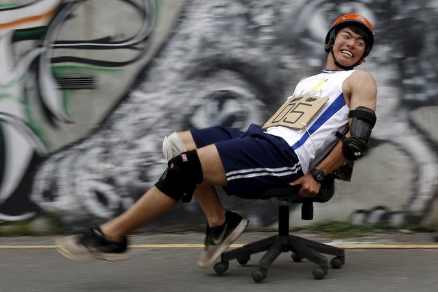 A competitor takes part in the office chair race ISU-1 Grand Prix in Tainan, southern Taiwan April 24, 2016. (Photo by Tyrone Siu/Reuters)
