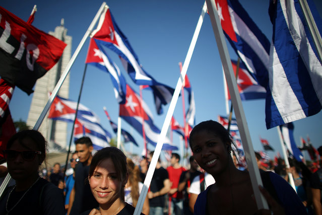 People carry Cuban flags during a May Day rally in Havana, Cuba, May 1, 2016. (Photo by Alexandre Meneghini/Reuters)